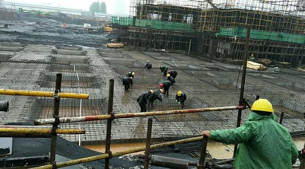 Construction site in heavy rain stainless steel welded pipes